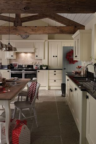 Country Kitchen with Breakfast nook, Soapstone counters, Limestone Tile, Custom hood, limestone tile floors, Exposed beam