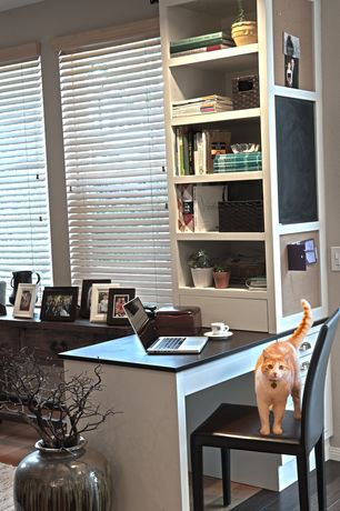 Traditional Home Office with Area rug, Hardwood floors, Built-in desk, Venetian blinds, Chalkboard, Built-in bookshelf