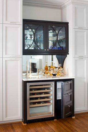 Modern Bar with Hardwood floors, Built-in bookshelf, Wine refrigerator, can lights, Paint, Paint 1, Crown molding, Ice maker