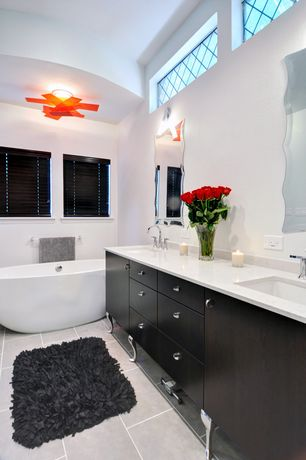Contemporary Master Bathroom with Flush, can lights, picture window, Bathtub, Freestanding, Simple marble counters
