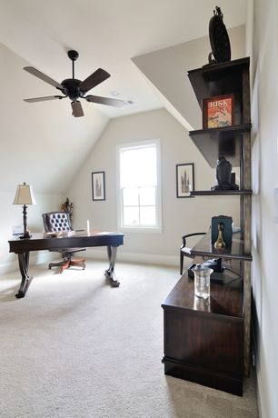 Traditional Home Office with Ceiling fan, Built-in bookshelf, Carpet