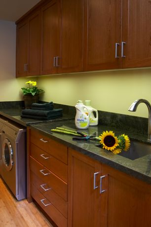 Modern Laundry Room with Standard height, Built-in bookshelf, laundry sink, Bamboo floors, can lights, Undermount sink, Paint