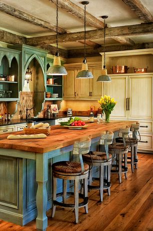 Country Kitchen with ELMWOOD RECLAIMED ANTIQUE HAND HEWN WOOD BEAMS, Kitchen island, Builder maple countertop, Breakfast bar