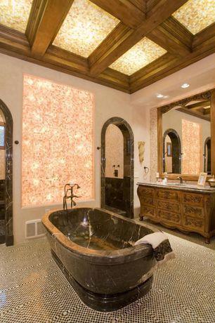 Mediterranean Master Bathroom with Undermount sink, Freestanding, Kingway stone emerald stone bathtub, High ceiling, Bathtub