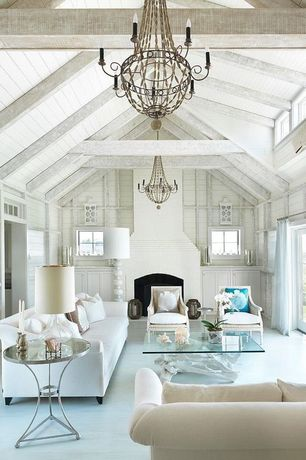 Cottage Living Room with High ceiling, Crown molding, Cement fireplace, Built-in bookshelf, Chandelier, Hardwood floors