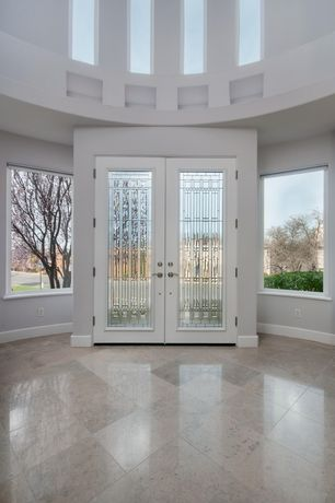 Contemporary Entryway with simple marble tile floors, French doors, High ceiling