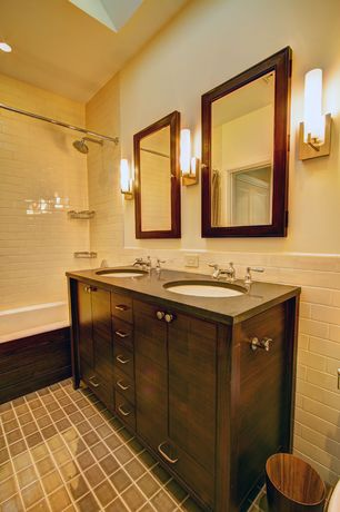 Traditional Full Bathroom with Soapstone counters, Wall sconce, Hammersmith subway tile, Flush, tiled wall showerbath