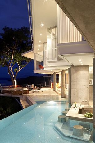 Contemporary Swimming Pool with exterior stone floors, Pathway, Casement, Infinity pool