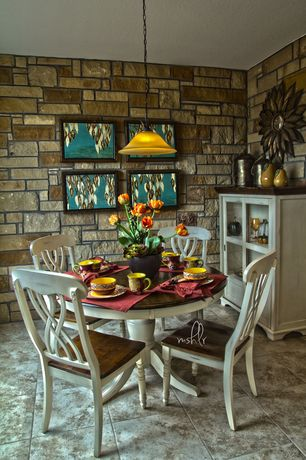 Traditional Dining Room with sandstone tile floors, Standard height, Pendant light, stone tile floors