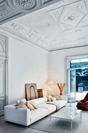 Living Room with French doors, Crown molding, Jackson condo sofa by edgar blazona for truemodern, Floor lamp, Concrete floors