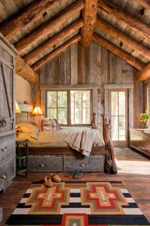 Master Bedroom with Crown molding, Built-in bookshelf, 3 tier oxford oval end table, French doors, Exposed beam, Log house