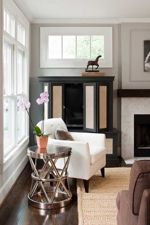Contemporary Living Room with Crown molding, stone fireplace, Hardwood floors