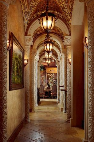 Art Deco Hallway with Cathedral ceiling, Columns, Pendant light, travertine tile floors, Wall sconce