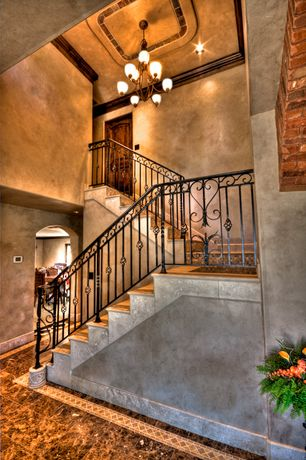 Mediterranean Staircase with Chandelier, High ceiling, Laminate floors, Crown molding