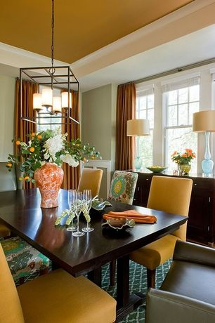 Contemporary Dining Room with Standard height, double-hung window, Chandelier, Carpet, Crown molding, Wainscotting