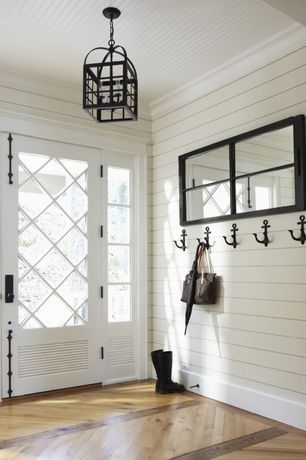 Cottage Entryway with Chandelier, Anchor wall hook, Glass panel door, Hardwood floors, Crown molding