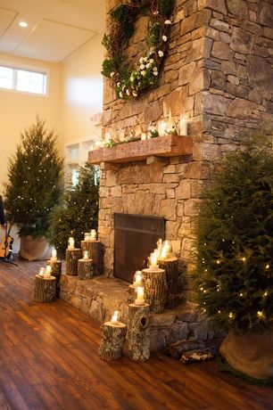 Rustic Living Room with Clerestory window, stone fireplace, A-Symmetrical Pine And Berry Wreath, High ceiling