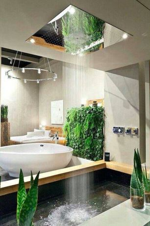 Contemporary Master Bathroom with Freestanding, High ceiling, Pendant light, Concrete, Rain shower, Master bathroom