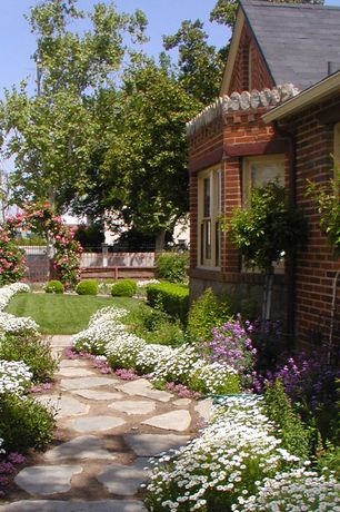 Traditional Landscape/Yard with double-hung window, exterior stone floors, Arbor, Fence, Pathway
