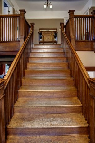 Craftsman Staircase with curved staircase, High ceiling, Hardwood floors