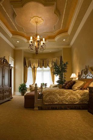 Traditional Master Bedroom with Chandelier, Standard height, Carpet, Paint, Built-in bookshelf, can lights, Crown molding