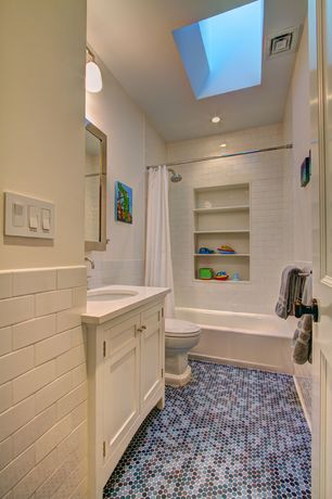 "Traditional Full Bathroom with Hammersmith subway tile 3"" x 6"", Flush, Moddotz blend penny tile, Corian counters, Skylight"