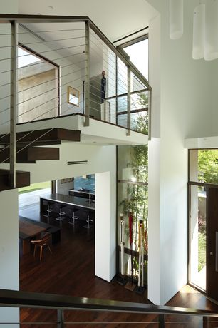 Contemporary Entryway with flat door, picture window, Hardwood floors, Cathedral ceiling, Transom window, Pendant light