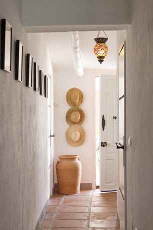 Eclectic Entryway with High ceiling, Exposed beam, terracotta tile floors, Chandelier