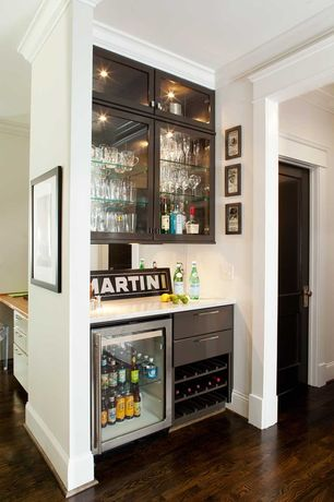 Contemporary Bar with Crown molding, Wine refrigerator, Mirror backsplash, Glass shelving, In cabinet lighting