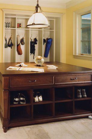 Craftsman Mud Room with Built-in bookshelf, sandstone tile floors, Pendant light, Crown molding