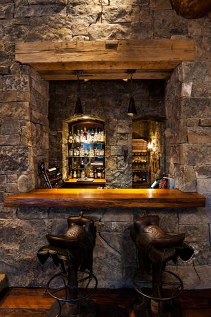 Rustic Bar with Exposed beam, Pendant light, Built-in bookshelf, Hardwood floors, Wall sconce