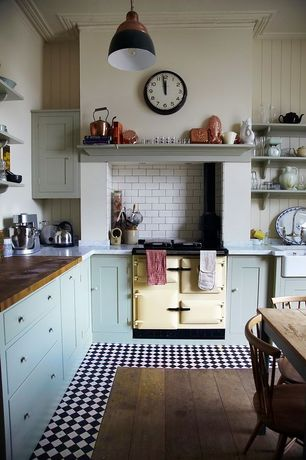 Country Kitchen with Builder oak counter top, L-shaped, Baldwin fireclay farmhouse sink - smooth apron, Flat panel cabinets