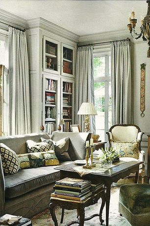 Traditional Living Room with picture window, Chair rail, Crown molding, Casement, Standard height, Carpet, Chandelier