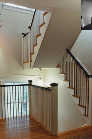 Contemporary Staircase with curved staircase, High ceiling, double-hung window, Hardwood floors, Pendant light