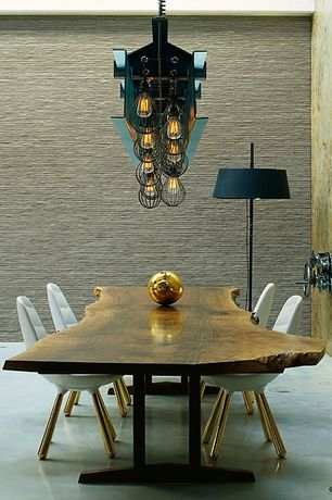 Contemporary Dining Room with interior wallpaper, Porcelanosa nara basic beige wall tile, Pendant light, Concrete floors