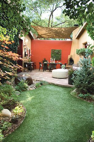 Contemporary Patio with exterior stone floors, exterior awning, Fence