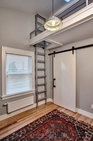 Traditional Master Bedroom with Ladder, Loft, Venetian blinds, Area rug, NPower Hanging Pendant Barn Light, Barn door