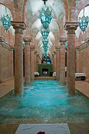 Mediterranean Swimming Pool with exterior stone floors, Moroccan-style light fixture, Columns, Indoor pool, Fireplace