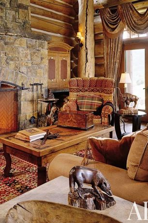 Rustic Living Room with Built-in bookshelf, Columns, French doors, Hardwood floors, stone fireplace, Fireplace, Exposed beam