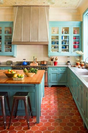 Country Kitchen with Flush, Custom hood, Limestone Tile, Stone Tile, Breakfast bar, Flat panel cabinets, penny tile floors