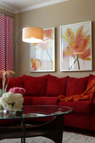 Contemporary Living Room with White area rug, Crown molding, Chevron curtain panels, Round glass coffee table, Red sofa