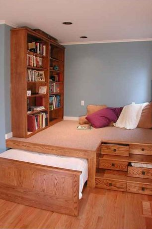 Craftsman Kids Bedroom with Laminate floors, Hardwood floors, Crown molding, Built-in bookshelf