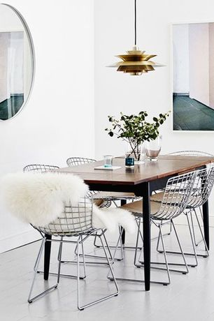 Contemporary Dining Room with Uttermost Large Oval Mirror, Hardwood floors, Design within reach - bertoia side chair