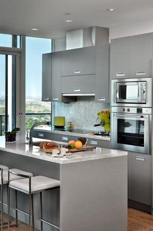 Contemporary Kitchen with European Cabinets, Transom window, Breakfast bar, MS International Granite White Tango, Flush
