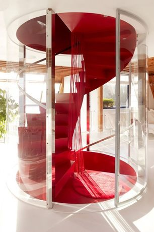 Modern Staircase with Spiral staircase, High ceiling, can lights, Hardwood floors