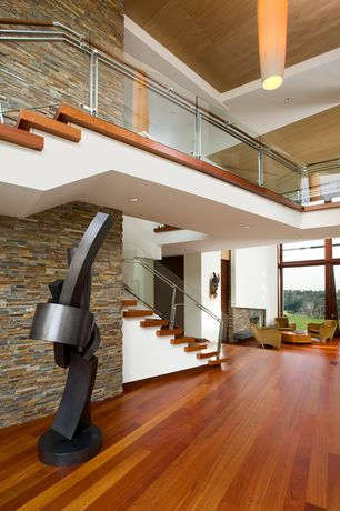 Modern Staircase with curved staircase, Loft, Standard height, can lights, Hardwood floors
