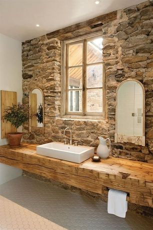 Rustic Full Bathroom with Veneerstone field stone cascade flats 10 sq. ft. handy pack manufactured stone, penny tile floors