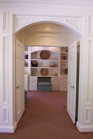 Traditional Hallway with High ceiling, Crown molding, Hardwood floors, French doors, Built-in bookshelf