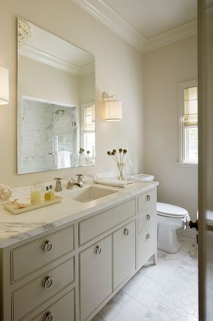 Traditional 3/4 Bathroom with Chandelier, Complex Marble, Wall sconce, Complex marble counters, frameless showerdoor