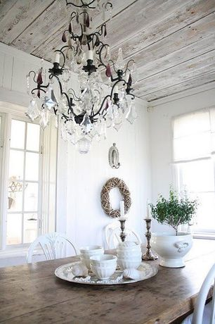 Eclectic Dining Room with Crown molding, Casement, Chandelier, Standard height, Wall sconce